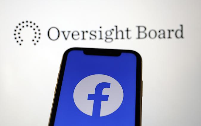 ANKARA, TURKEY - MAY 07: Facebook logo is seen on a smartphone as Oversight Board at the background in Ankara, Turkey on May 07, 2020. (Photo by Hakan Nural/Anadolu Agency via Getty Images)
