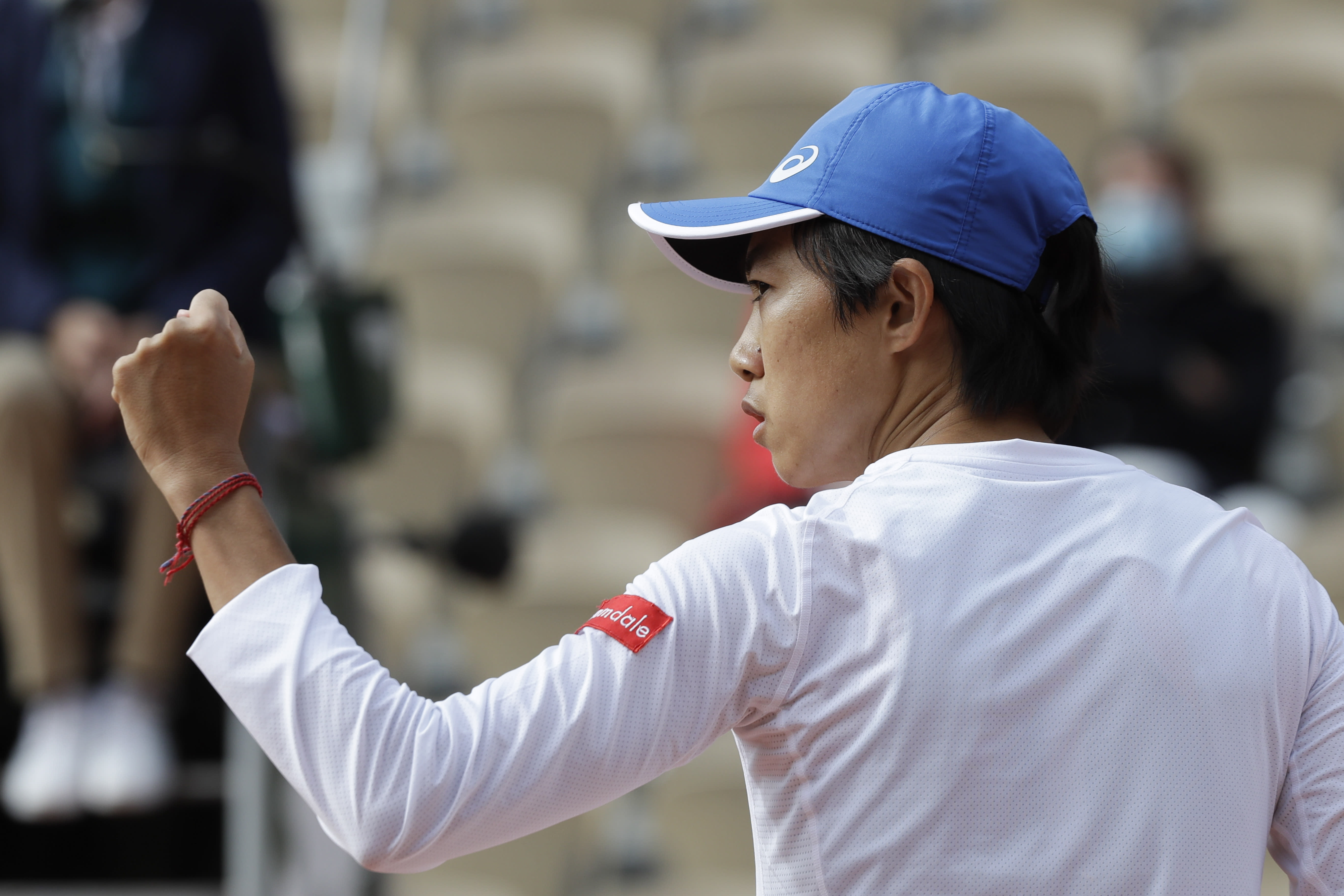 China's Zhang Shuai clenches her fist after scoring a point against France's Clara Burel in the third round match of the French Open tennis tournament at the Roland Garros stadium in Paris, France, Saturday, Oct. 3, 2020. (AP Photo/Alessandra Tarantino)
