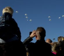 Parachutists jump over Dutch heath to mark WWII operation