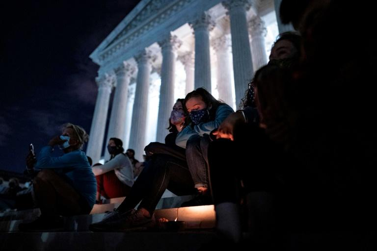 People gather before the Supreme Court on September 18, 2020 to pay homage to Ginsburg, just hours after her death was announced