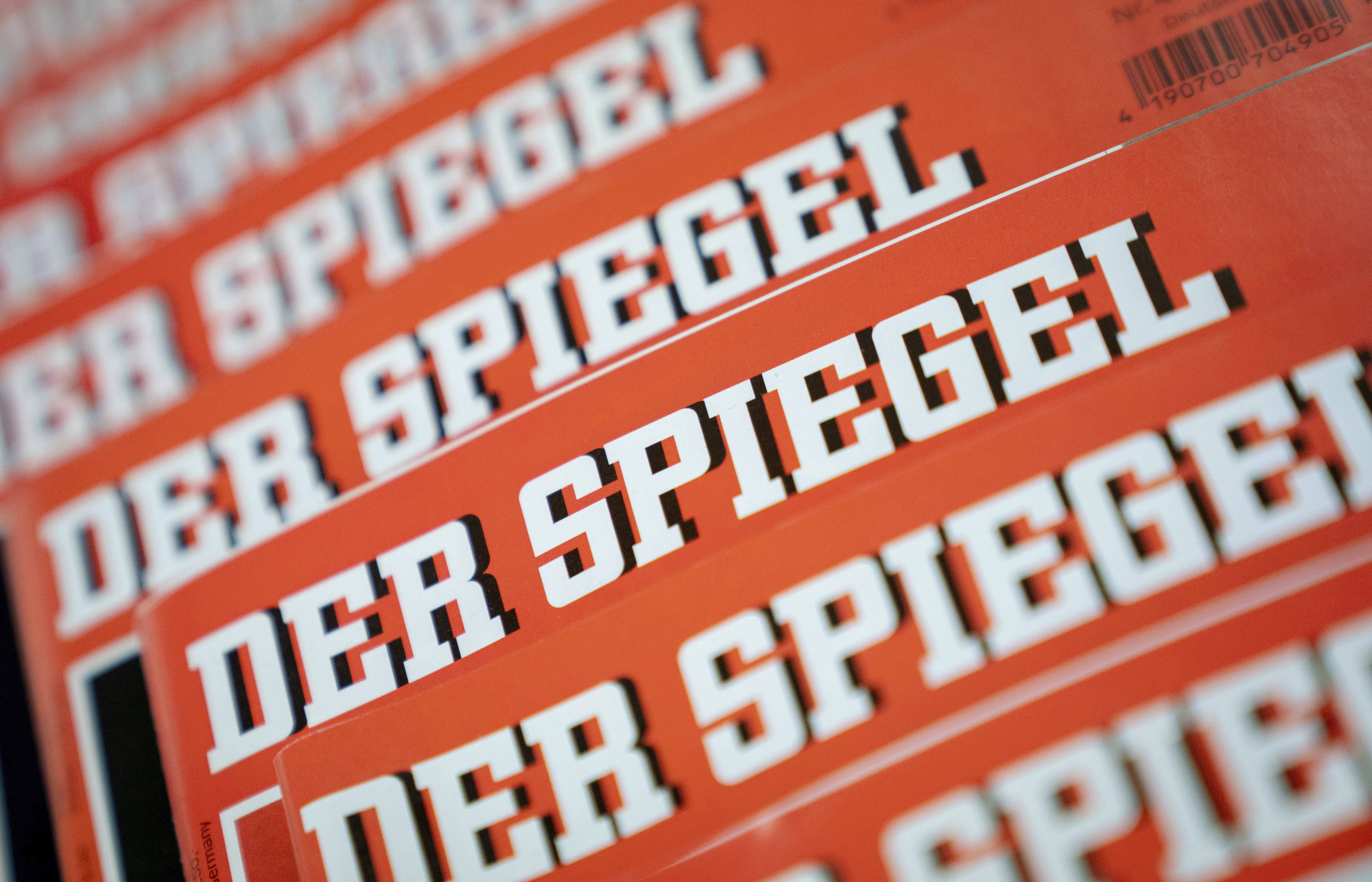 "The Dec. 19, 2018 photo shows issues of German news magazine Spiegel arranged on a table in Berlin. An award-winning journalist who worked for Der Spiegel, one of Germany's leading news outlet, has left the publication after being found to have committing what the weekly described Wednesday as journalistic fraud ""on a grand scale"" over a number of years. (Kay Nietfeld/dpa via AP)"