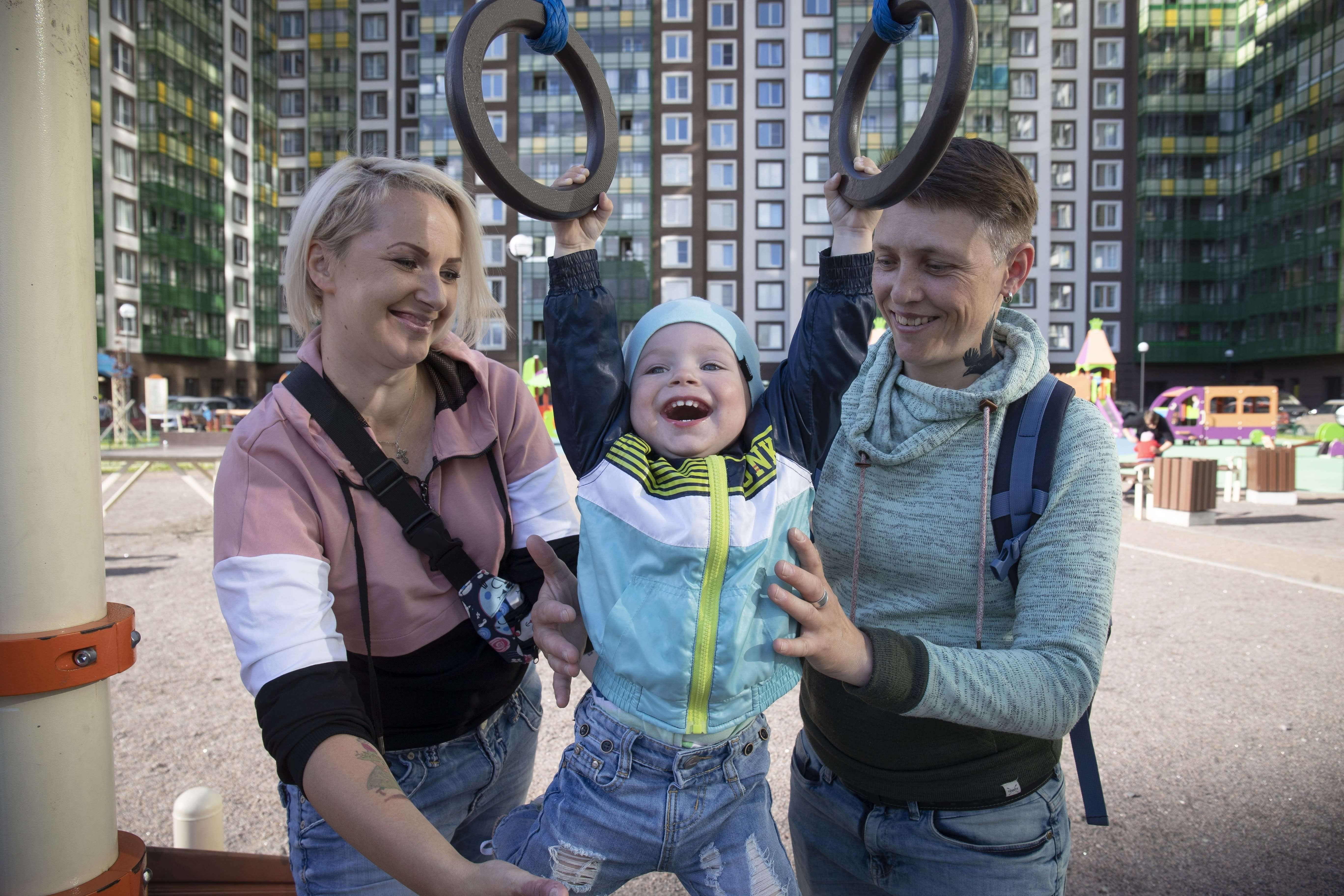 Irina, right, and Anastasia Lagutenko play with their son, Dorian, at a playground in St. Petersburg, Russia, July 2, 2020. Their 2017 wedding wasn't legally recognized in Russia. Any hopes they could someday officially be married in their homeland vanished July 1 when voters approved a package of constitutional amendments, one of which stipulates that marriage in Russia is only between a man and a woman. (AP Photo)