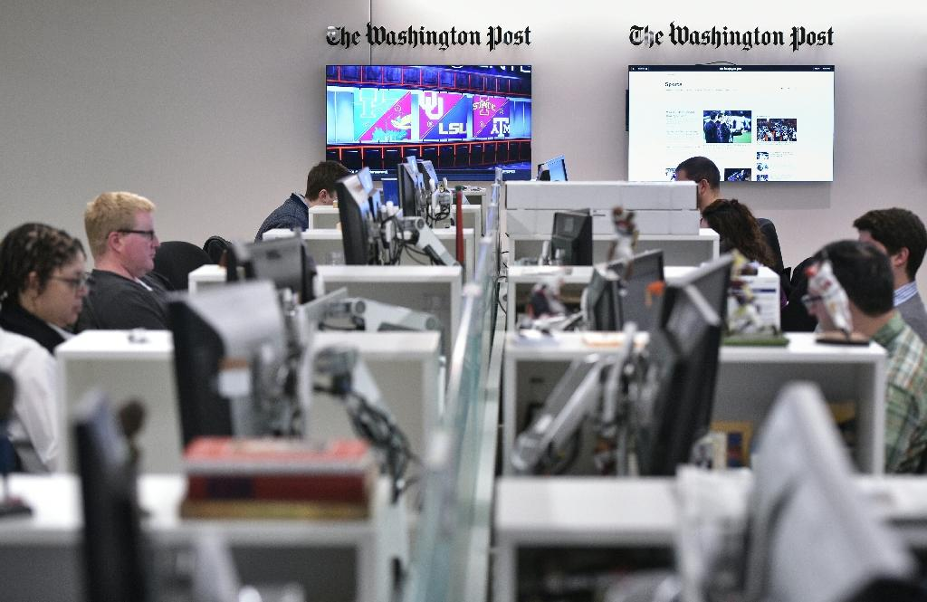 The Washington Post is also offering its content for free through websites of smaller newspapers around the United States (AFP Photo/Mandel Ngan)