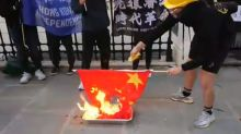 Beijing urges swift British response to burning of Chinese flag, Hong Kong pro-independence chants outside its London embassy