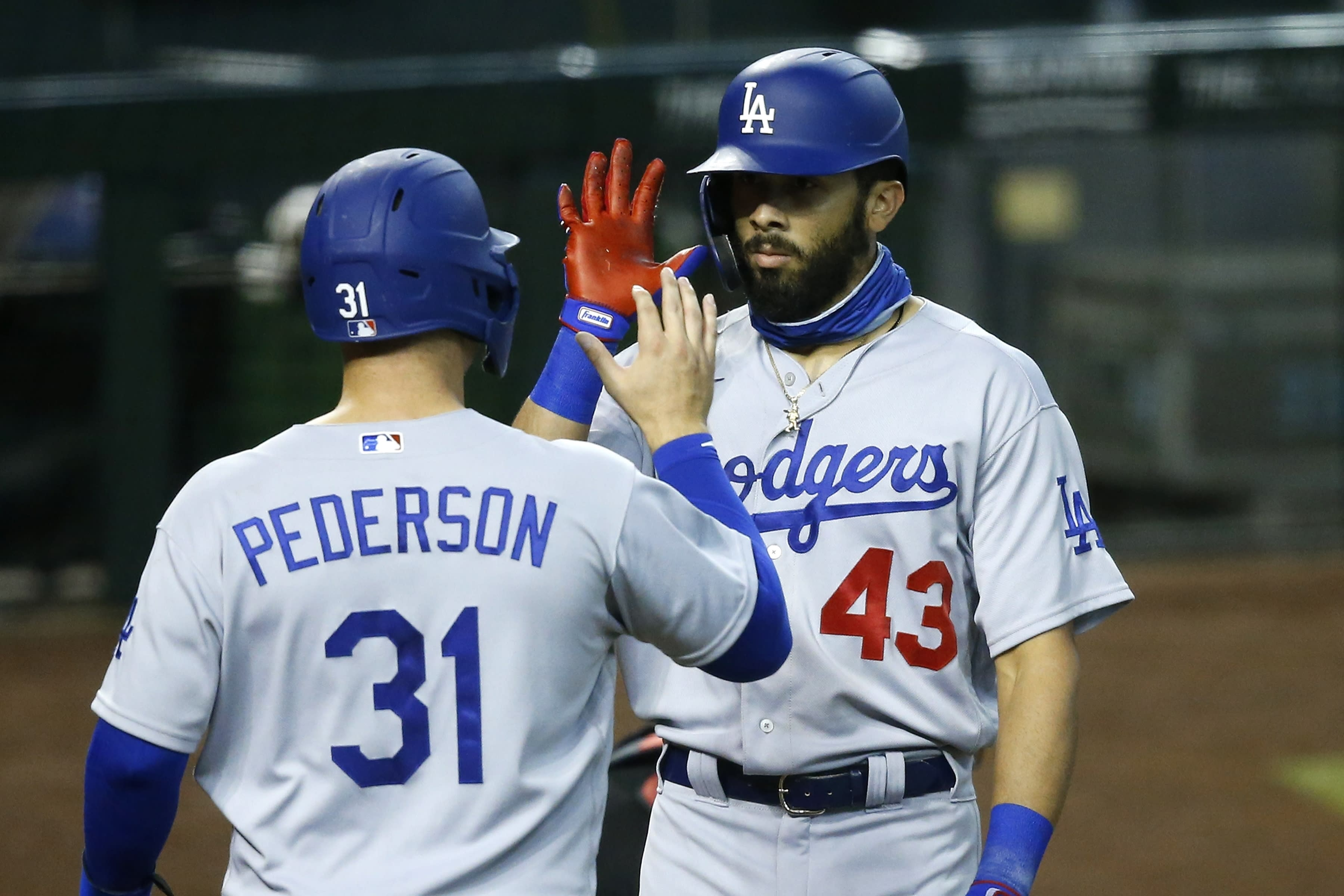 Los Angeles Dodgers' Edwin Rios (43) celebrates his two-run home run against the Arizona Diamondbacks with Joc Pederson (31) during the fourth inning of a baseball game Saturday, Aug. 1, 2020, in Phoenix. (AP Photo/Ross D. Franklin)