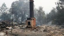 California crews hold wildfire in check, let more residents go home