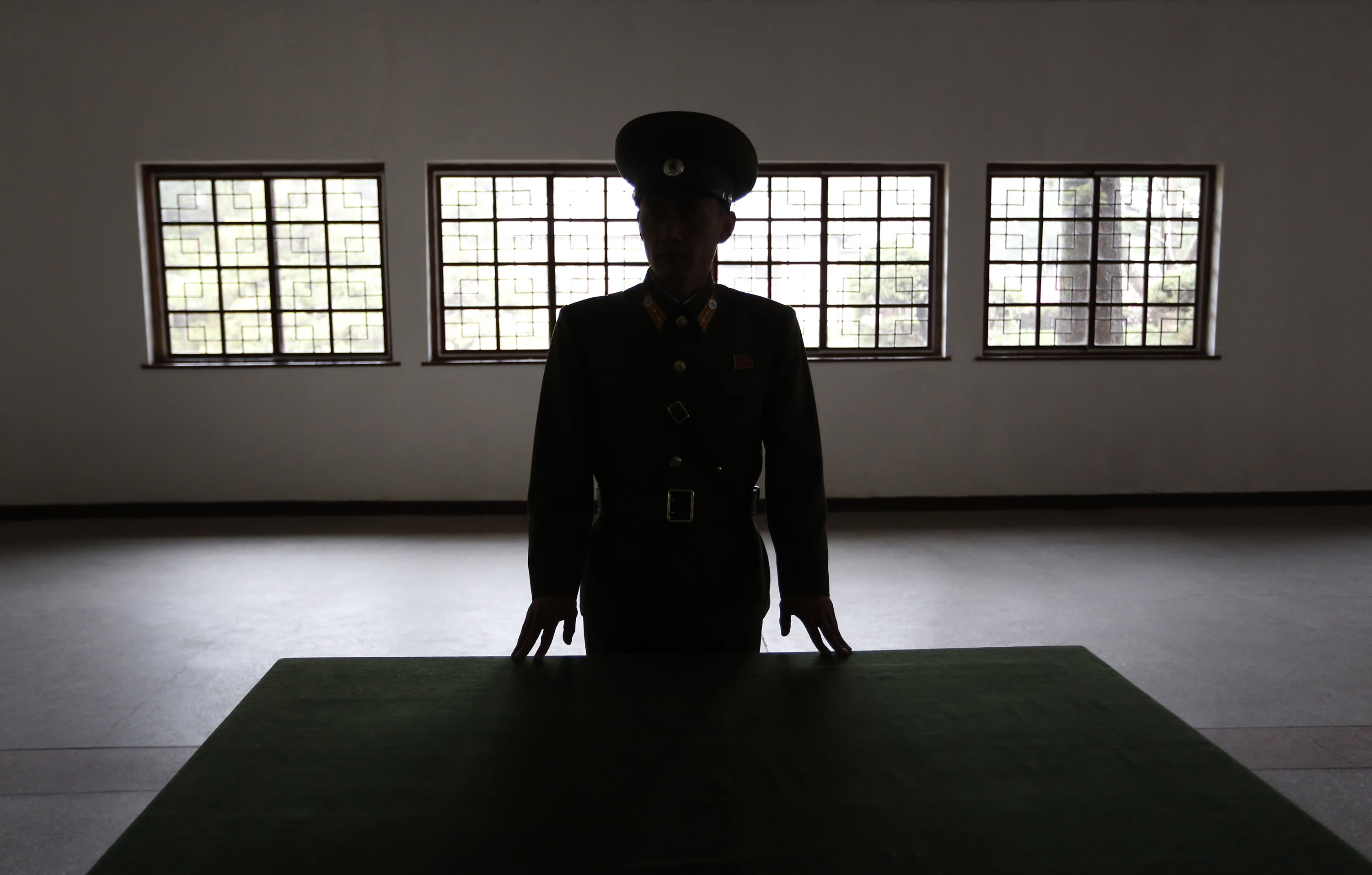 """A North Korean military officer talks the history at a museum hall at Demilitarized Zone that separates the two Koreas in Panmunjom, North Korea Monday, April 23, 2012. North Korea promised Monday to reduce South Korea's conservative government """"to ashes"""" in less than four minutes, in an unusually specific escalation of recent threats aimed at its southern rival. The statement by North Korea's military, carried by state media, comes amid rising tensions on the Korean peninsula. Both Koreas recently unveiled new missiles, and the North unsuccessfully launched a long-range rocket earlier this month. (AP Photo/Vincent Yu)"""