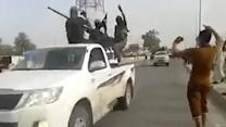 Raw: ISIL Militants Parade Through Beiji