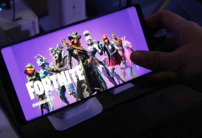 PARIS, FRANCE - OCTOBER 26:  A gamer plays the video game 'Fortnite Battle Royale' developed by Epic Games on a Samsung Galaxy Note 9 smartphone during the 'Paris Games Week' on October 26, 2018 in Paris, France. 'Paris Games Week' is an international trade fair for video games and runs from October 26 to 31, 2018.  (Photo by Chesnot/Getty Images)