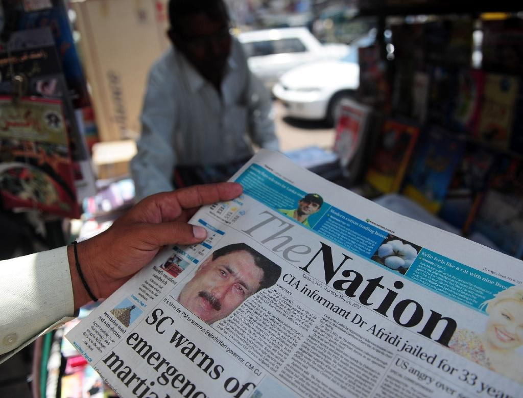 A newspaper bears the photograph of Pakistani surgeon Shakeel Afridi, recruited by the CIA to help find Osama bin Laden, at a newsstand in Karachi on May 24, 2012 (AFP Photo/Asif Hassan)