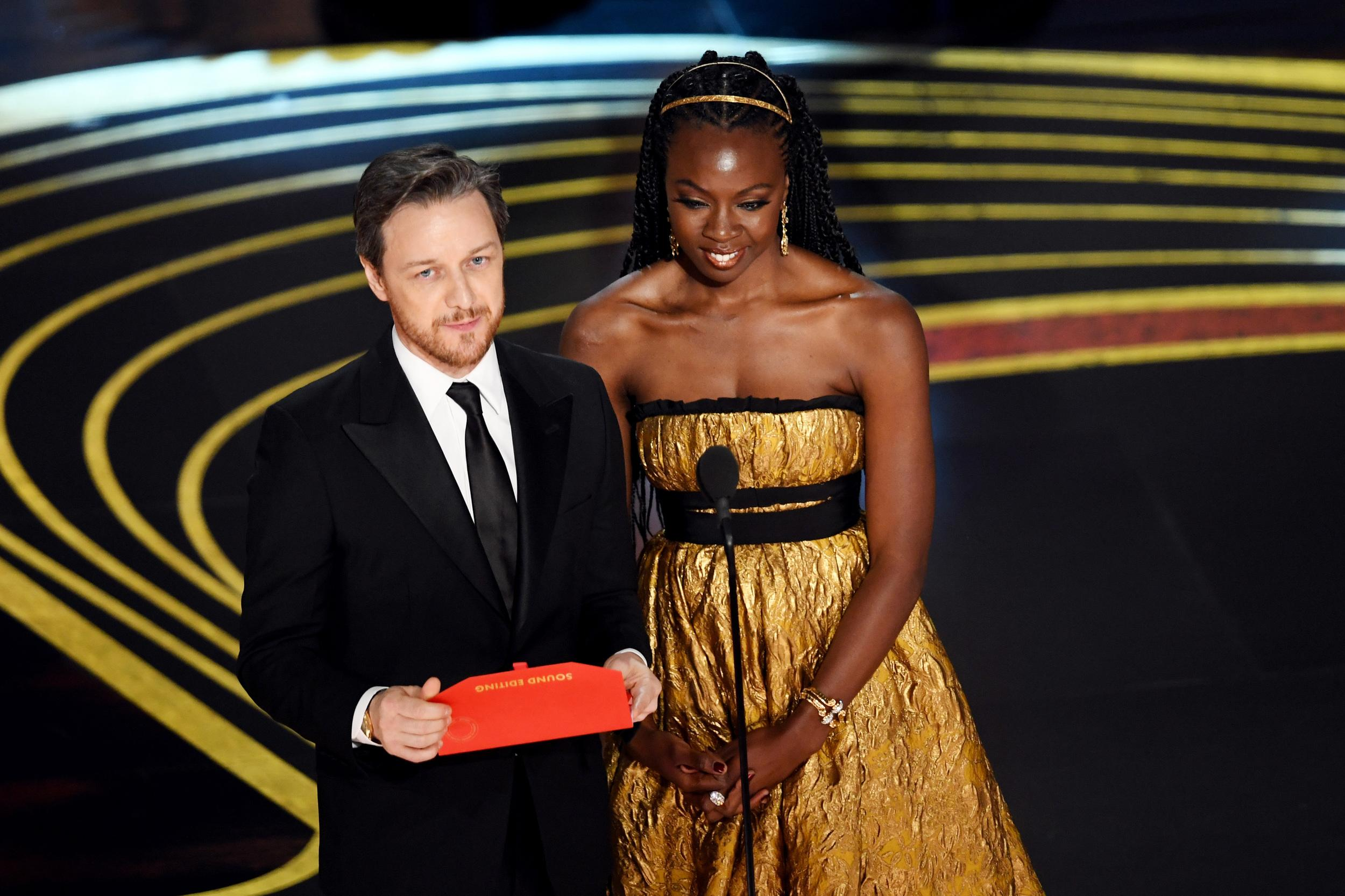 HOLLYWOOD, CALIFORNIA - FEBRUARY 24: (L-R) James McAvoy and Danai Gurira speak onstage during the 91st Annual Academy Awards at Dolby Theatre on February 24, 2019 in Hollywood, California. (Photo by Kevin Winter/Getty Images)