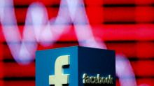 Facebook shares slide after reports of data misuse