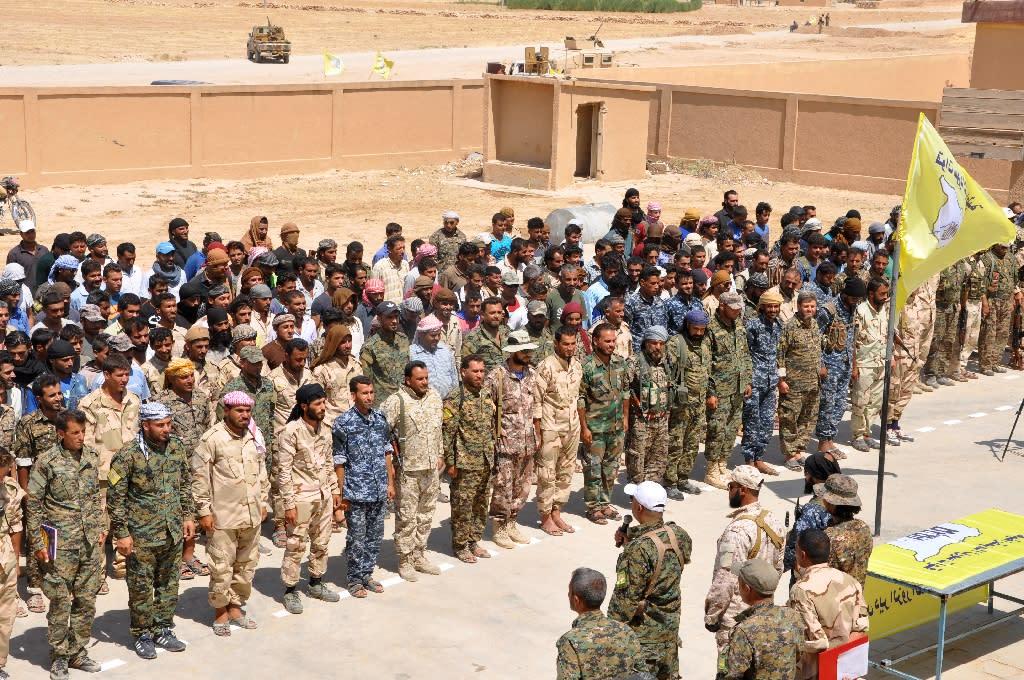 Members of the Deir Ezzor Military Council listen to their leader Ahmad Abu Khawlah (bottom-C) in Shadadi on August 25, 2017 (AFP Photo/Ayham al-Mohammad)