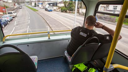 Police stake out motorists from top deck of the bus to catch mobile phone offenders