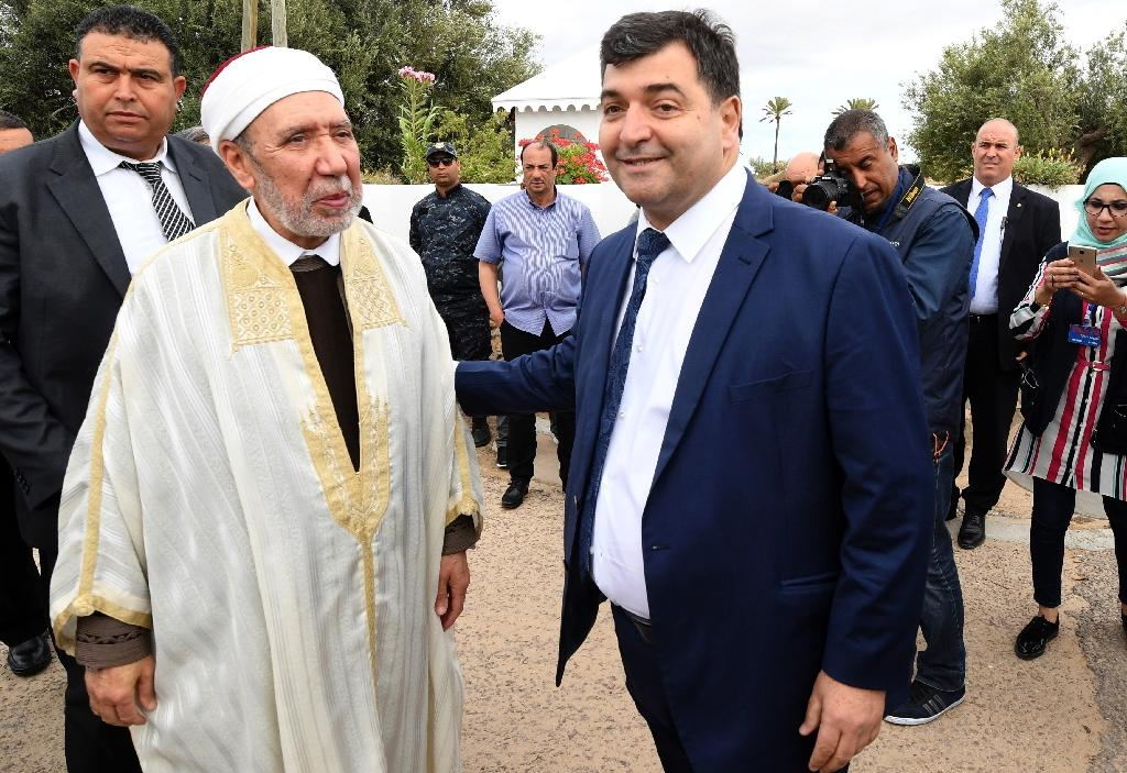 Tunisia's new tourism minister Rene Trabelsi (R) meets the country's Grand Mufti Othman Battikh at the Ghriba Synagogue on Djerba island on May 02, 2018