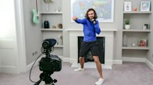 Joe Wicks reacts to receiving an MBE from the Queen for his efforts during Covid