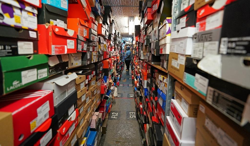 A worker handles some of the hundreds of pairs of sneakers stocked at Stadium Goods (AFP Photo/Don EMMERT)