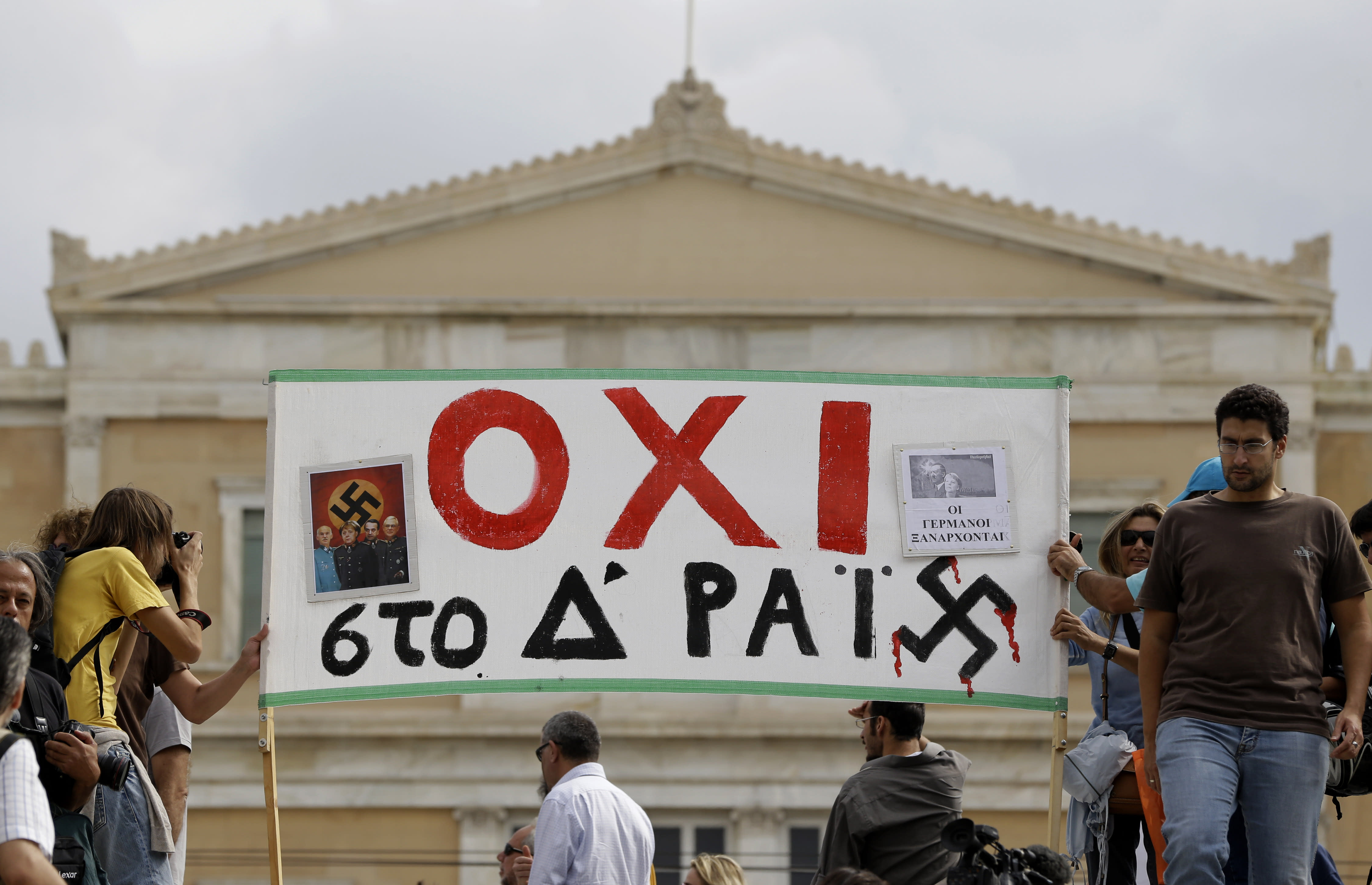"Demonstrator display a banner that reads "" NO to the 4th Reich"" prior to an protest in Athens on Tuesday Oct. 9, 2012. German Chancellor Angela Merkel makes her first visit to Greece since the eurozone crisis began here three years ago. Her five-hour stop is seen by the government as a historic boost for the country's future in Europe's shared currency, but by protesters as a harbinger of more austerity and hardship. More than 7,000 police will be on hand, cordoning off parks and other sections of central Athens, to keep demonstrators away from the German leader who is due to arrive Tuesday in the Greek capital for talks with conservative Prime Minister Antonis Samaras. (AP Photo/Lefteris Pitarakis)"