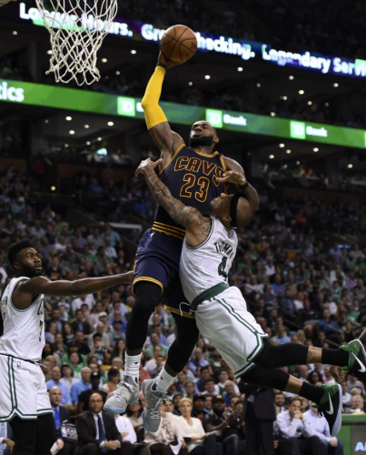 Isaiah Thomas tries to stop LeBron James from getting to the rim in Game 1 of the Eastern Conference finals. (USA Today)