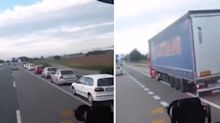Drivers queue behind stopped truck for literally no reason