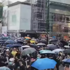 Clashes Between Protesters and Police in Kowloon Follow Masked March