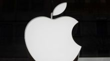 Apple shares dive; rare revenue warning drags global markets