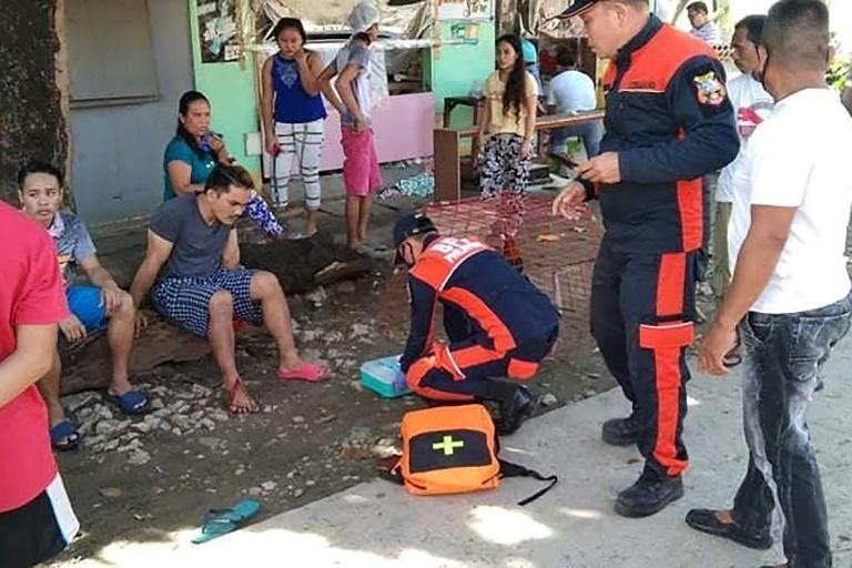 Rescuers treat an injured resident near the town of Cataingan in the central Philippine province of Masbate