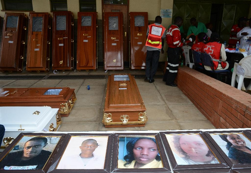 Portraits of the slain Garissa University students outside the Chiromo morgue in Nairobi on April 9, 2015 (AFP Photo/Simon Maina)