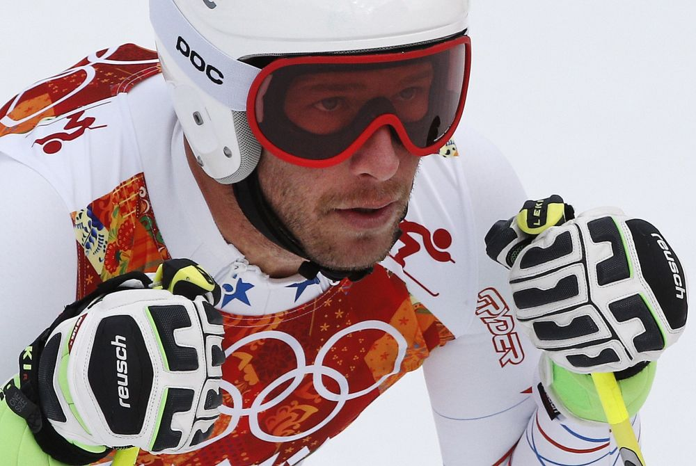 United States' Bode Miller pauses in the finish area after completing Men's super combined downhill training at the Sochi 2014 Winter Olympics, Tuesday, Feb. 11, 2014, in Krasnaya Polyana, Russia