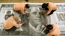 Dollar edges lower as currencies retrace Friday's moves