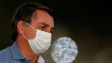 Brazil's Bolsonaro removes mask in public after coronavirus recovery