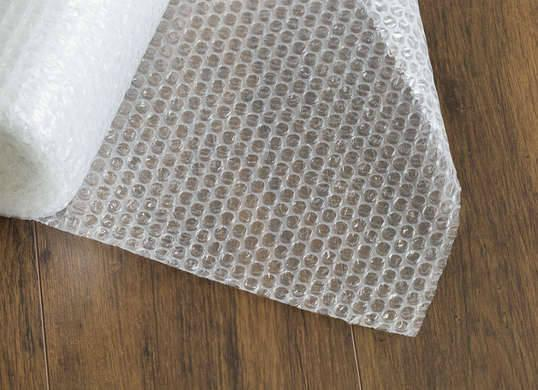 """<p>When it comes to heat loss, windows are one of the biggest culprits, so it's important to insulate them properly. For an inexpensive fix, cut a piece of bubble wrap to fit perfectly inside the window frame, spray a thin film of water on the window, and place the bubble wrap on the glass. The layer of plastic will <a href=""""http://www.bobvila.com/slideshow/8-bright-ideas-to-boost-natural-light-48551"""" rel=""""nofollow noopener"""" target=""""_blank"""" data-ylk=""""slk:let the sunlight in"""" class=""""link rapid-noclick-resp"""">let the sunlight in</a> while keeping the warmth where it belongs: inside. <i>Photo: fotosearch.com</i><br>RELATED: <a href=""""http://www.bobvila.com/slideshow/drafty-windows-solutions-for-every-budget-48200"""" rel=""""nofollow noopener"""" target=""""_blank"""" data-ylk=""""slk:Drafty Windows? Solutions for Every Budget"""" class=""""link rapid-noclick-resp"""">Drafty Windows? Solutions for Every Budget</a></p>"""