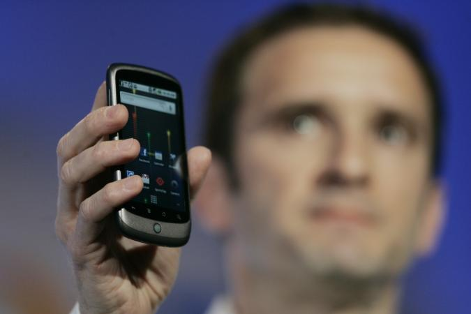 Mario Queiroz, Vice President of Product Management for Google, holds up the Nexus One smartphone running on the Google Android platform, the first mobile phone the internet company will sell directly to consumers, during a news conference at Google headquarters in Mountain View, California on January 5, 2010.    AFP PHOTO/Robert Galbraith/POOL (Photo by - / POOL / AFP)        (Photo credit should read -/AFP via Getty Images)
