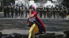Tens of thousands of Venezuelans march against government