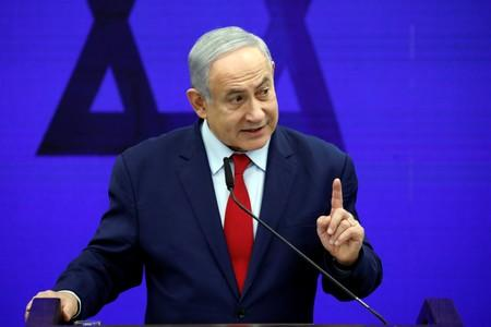 Israel strikes Gaza after rocket sirens force Netanyahu off stage