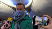 Chaos Engulfs Airport as Navalny Lands Back Home to Face Down Putin