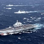 China carrier fleet passes near rival Taiwan