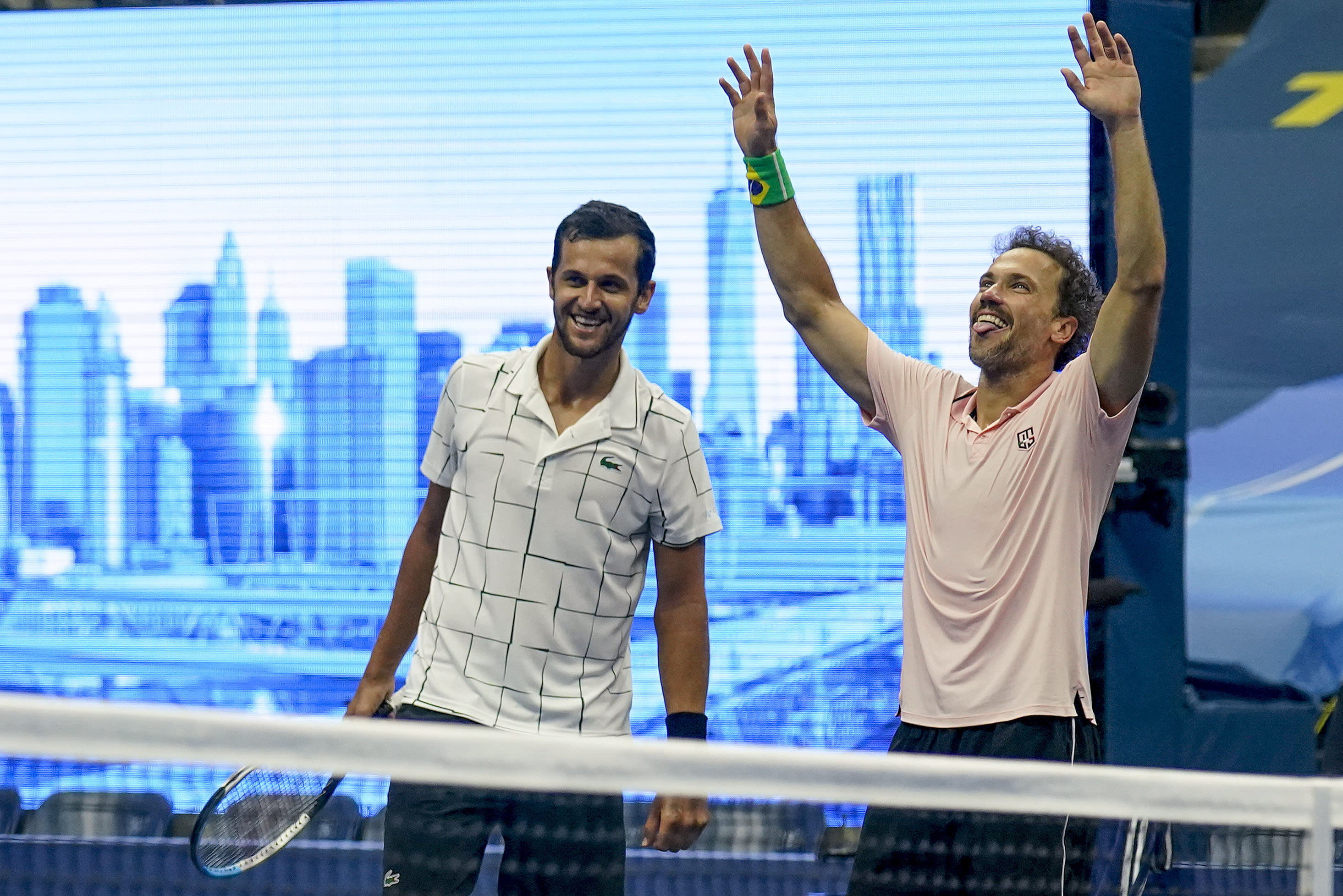 Mate Pavic, of Croatia, left, and Bruno Soares, of Brazil, celebrate winning the men's doubles final against Wesley Koolhof, of the Netherlands, and Nikola Mektic, of Croatia, during the US Open tennis championships, Thursday, Sept. 10, 2020, in New York. (AP Photo/Seth Wenig)