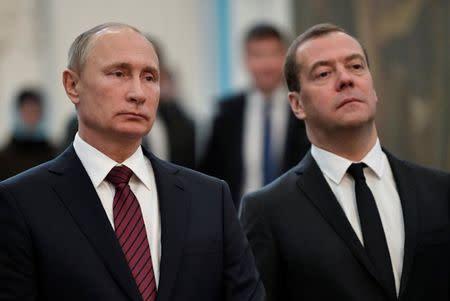 FILE PHOTO - Russia's President Vladimir Putin and Prime Minister Dmitry Medvedev visit the Resurrection New Jerusalem Monastery at Istra