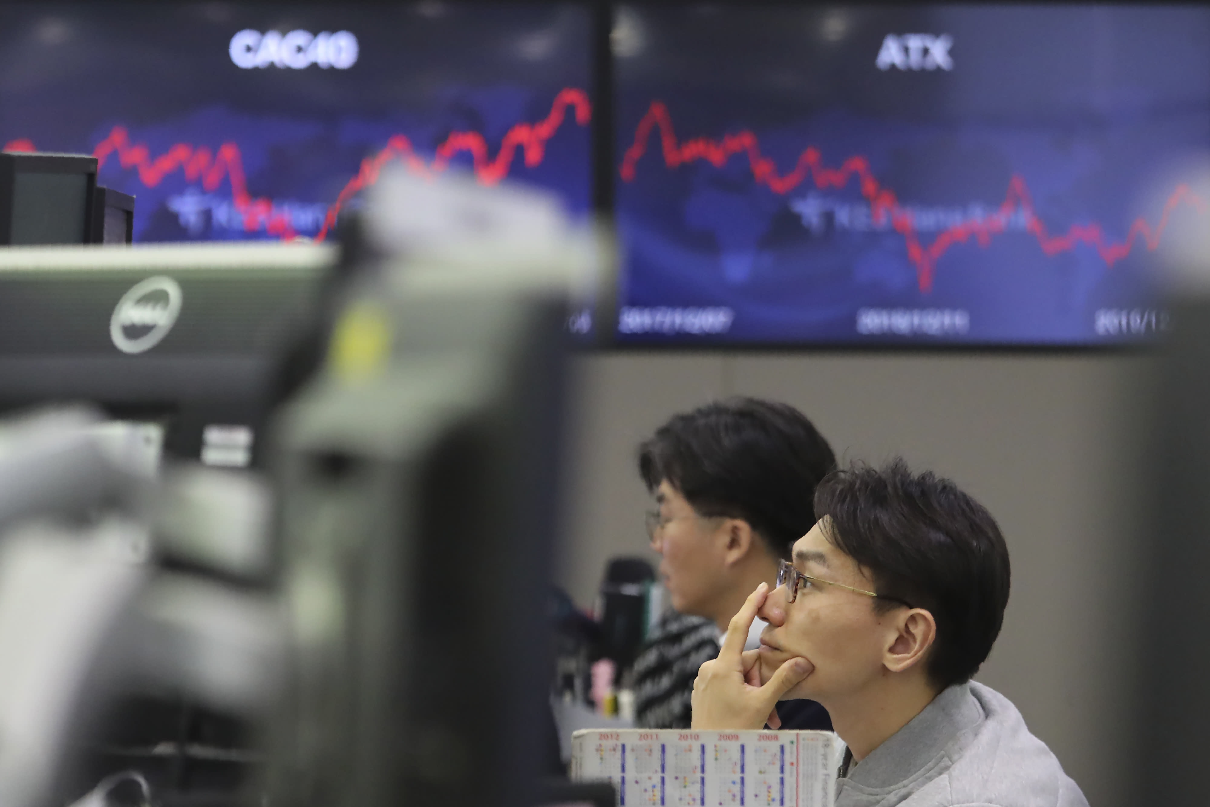 A currency trader watches monitors at the foreign exchange dealing room of the KEB Hana Bank headquarters in Seoul South Korea Monday Dec. 9 2019. Asian shares were mostly higher Monday cheered by a buying mood on Wall Street that came at the end of