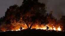Wildfires in Southern California force thousands to flee