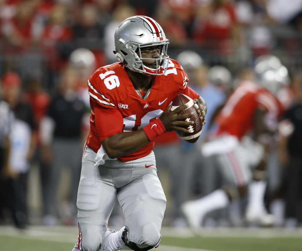 J.T. Barrett is taking some heat for the Buckeyes' offensive struggles against elite teams. (AP)