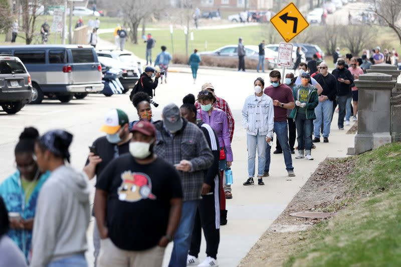 FILE PHOTO: Voters wait to cast ballots during the presidential primary election in Wisconsin