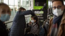 Coronavirus travel ban throws Americans abroad into panic, airports in chaos