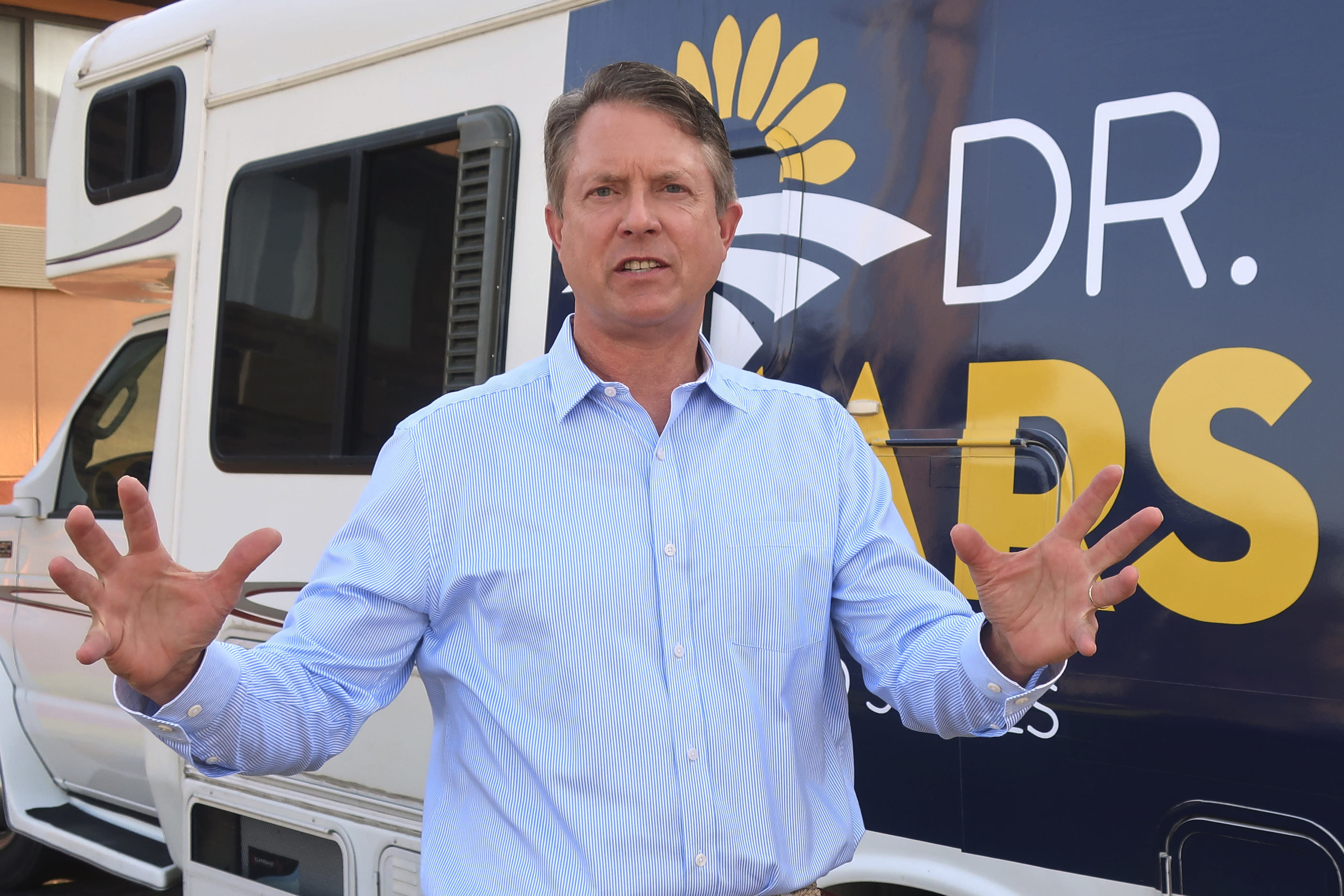 """FILE - In this Sept. 5, 2019 file photo, U.S. Rep. Roger Marshall, R.-Kan., speaks to an Associated Press reporter outside an RV he uses in traveling the state, during a visit to Topeka, Kansas. Political icon and 1996 Republican presidential nominee Bob Dole on Monday Jan. 13, 2020, endorsed western Kansas' congressman in the state's GOP Senate primary. Marshall's campaign announced Dole's backing and Dole tweeted that Marshall is """"a true friend to KS."""" Marshall has served in Congress since 2017. (AP Photo/John Hanna,File)"""
