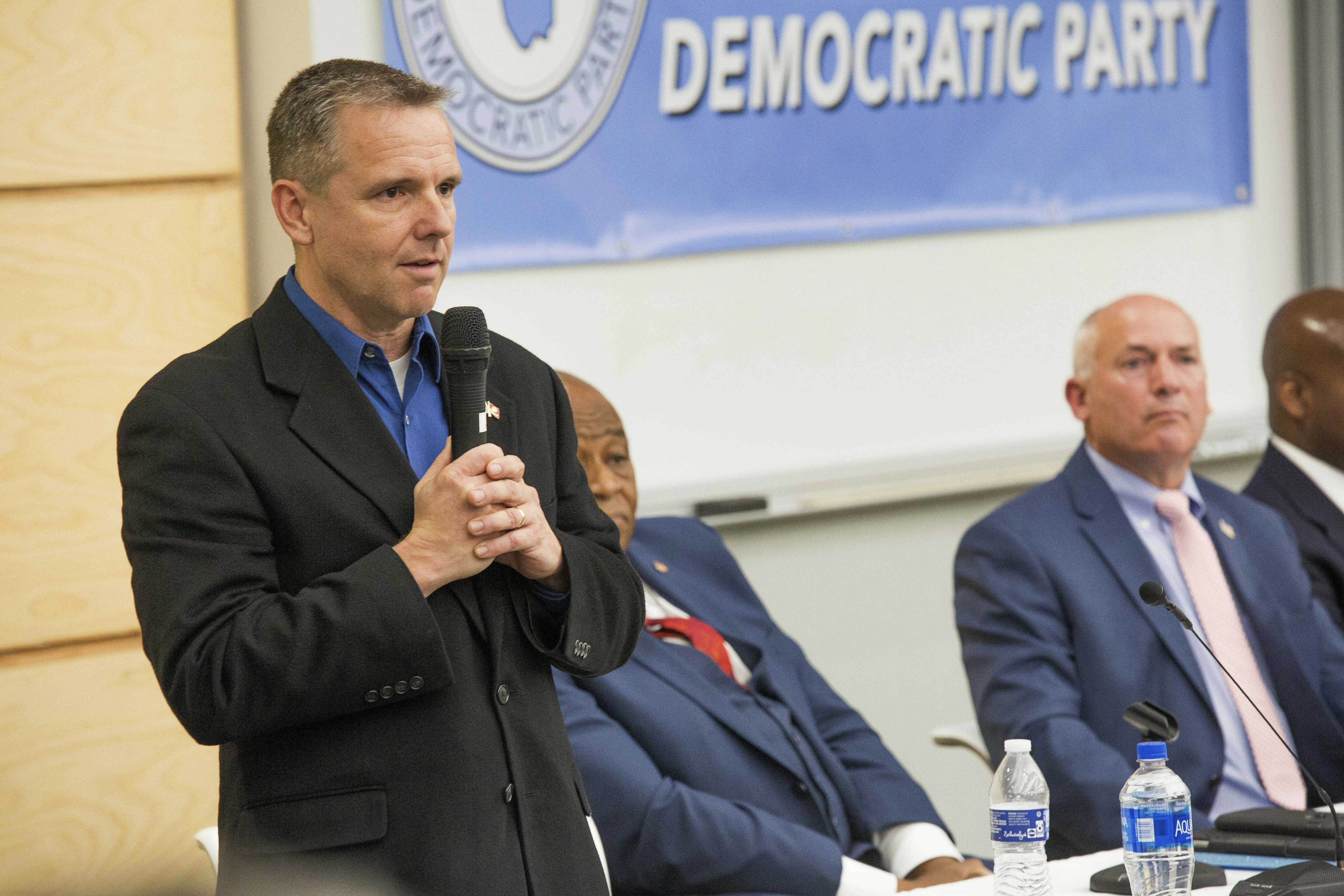 This photo taken April 15, 2019, shows Richard Bew speaking during a forum held by the Pitt County Democratic Party for the Third Congressional District candidates in Winterville, N.C. U.S. Rep. Walter Jones Jr.'s long-held congressional seat in North Carolina was expected to be up for grabs soon, but it happened more quickly than most people anticipated. Months after the Republican announced his 2018 campaign would be his last, Jones' health faded. He died in February at age 76. Jones' death drew people from both sides of the aisle to praise his commitment to his constituents, his faith and his willingness to buck party leadership regardless of political consequences, such as when he opposed the Iraq War. It also drew more than two dozen candidates from four parties into an accelerated, off-year special election to replace him in the GOP-leaning 3rd Congressional District. (Juliette Cooke/The Daily Reflector via AP)