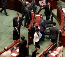Hong Kong assembly in chaos; attack on democracy leader a 'chilling signal'