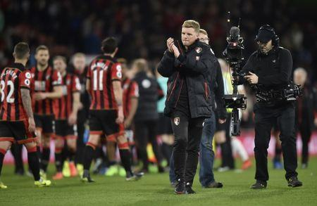 Bournemouth manager Eddie Howe applauds fans after the game