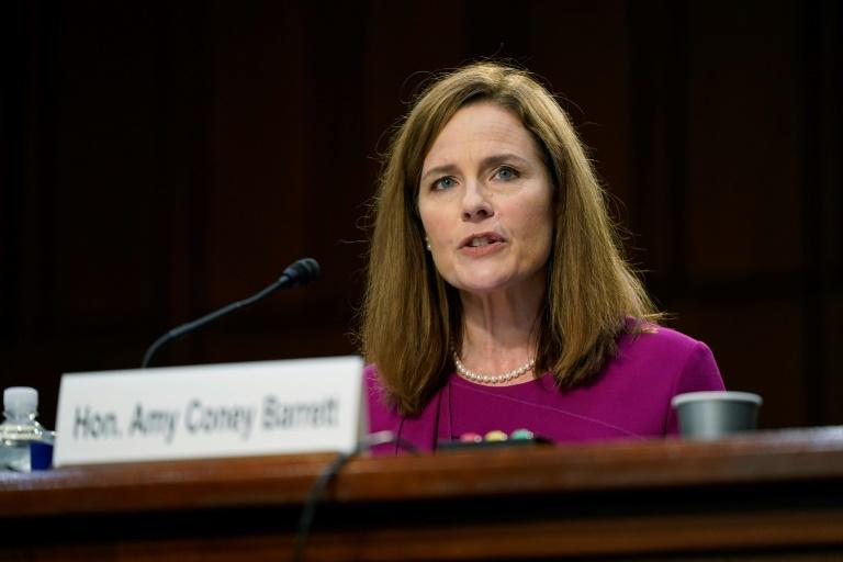 US President Donald Trump lauded his Supreme Court nominee Amy Coney Barrett, pictured speaking at her Senate Judiciary Committee confirmation hearing on October 12, 2020