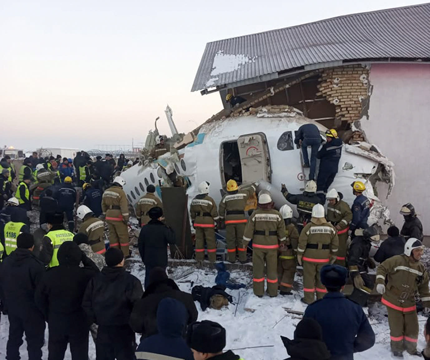 At least 14 dead as plane with 98 people on board crashes